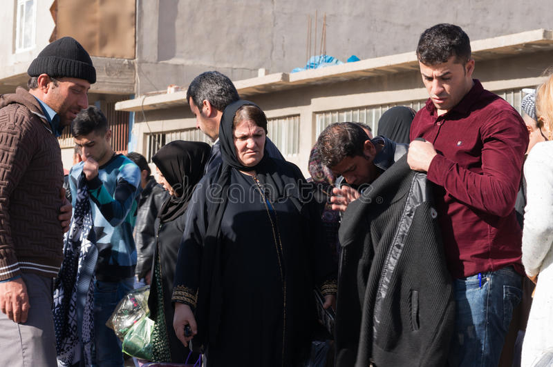 People shopping for clothes in Iraq. People shopping for winter clothes in a flea market in Iraq royalty free stock photo