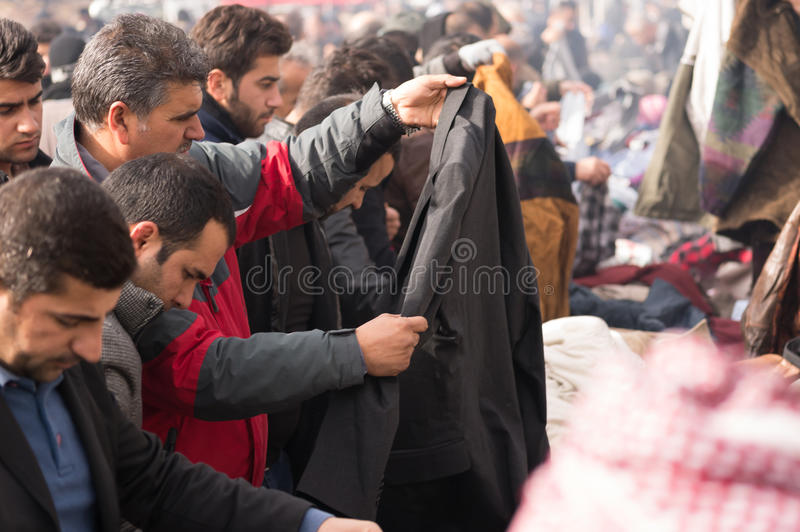 People shopping for clothes in Iraq. People shopping for winter clothes in a flea market in Iraq royalty free stock images