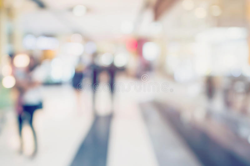 People shopping in department store. Defocused blur background royalty free stock photography