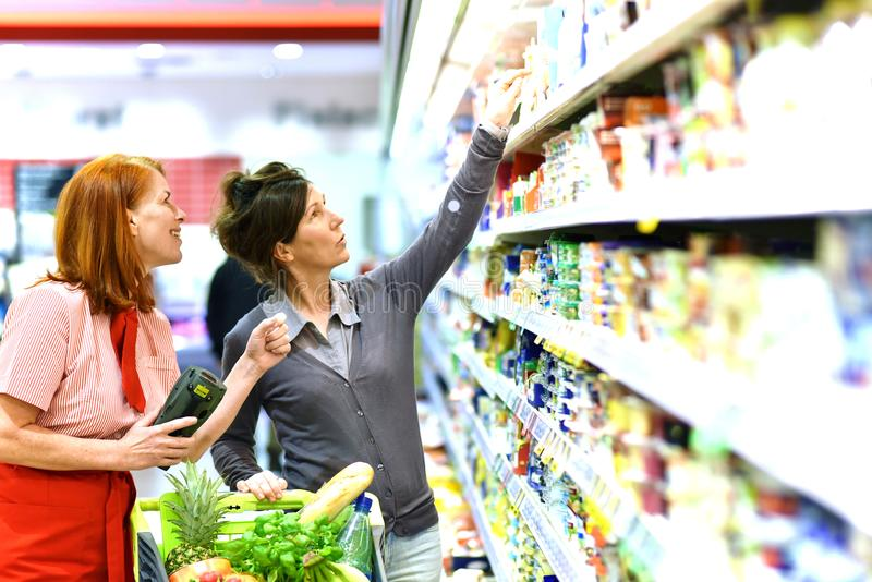 People shopping for food in the supermarket stock image