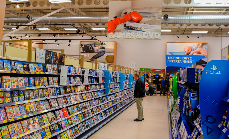 People shopping Games & DVDs. A picture of a man shopping the Games & DVD section of a shop / supermarket royalty free stock photography