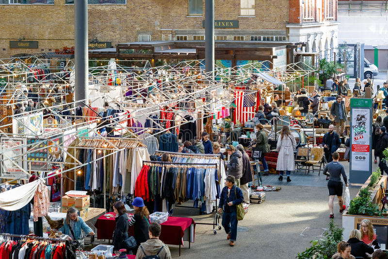 People shopping at Old Spitalfields Market in London stock photography
