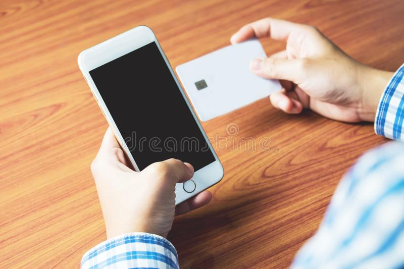 People are shopping online on mobile stock photos
