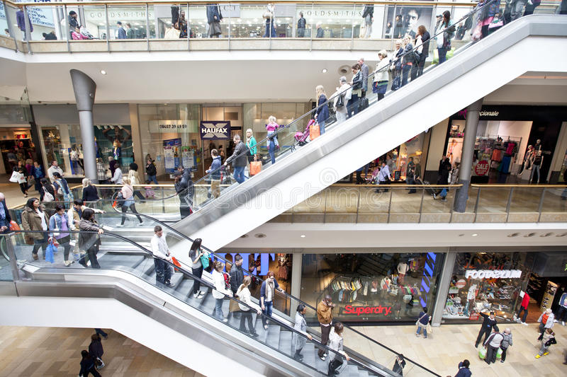 People shopping in retail mall. People shopping and using escalators in the modern Bullring retail mall / centre, Birmingham, UK stock image