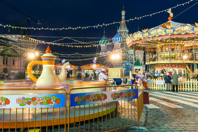People shopping, ride a carousel and walking at New Year's market on the Red Square royalty free stock photos