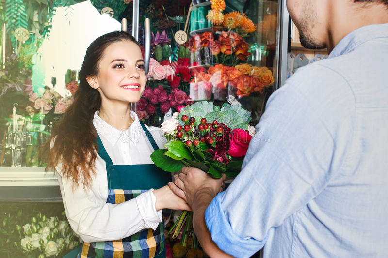 People, shopping, sale, floristry and consumerism concept. Shopping, sale, floristry and consumerism concept worker stock photos