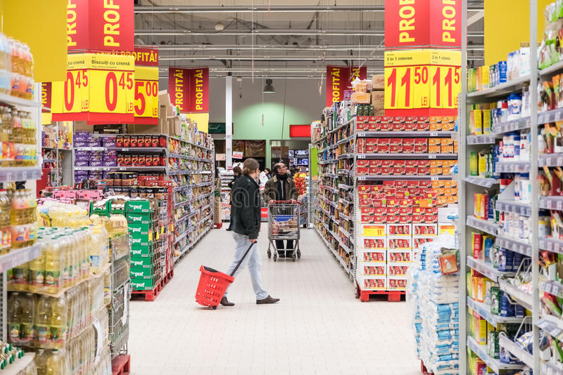 People Shopping In Supermarket Store Aisle. BUCHAREST, ROMANIA - MARCH 01, 2015: People Shopping In Supermarket Store Aisle royalty free stock image