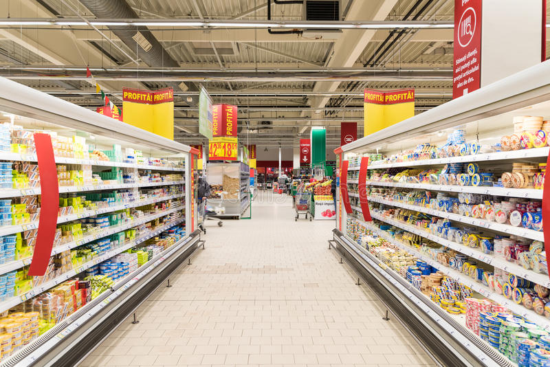 People Shopping In Supermarket Store Aisle. BUCHAREST, ROMANIA - MARCH 01, 2015: People Shopping In Supermarket Store Aisle stock photos