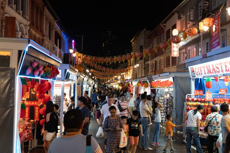 People shopping on a traditional market in Chinatown Singapore before Chinese New Year celebration royalty free stock images