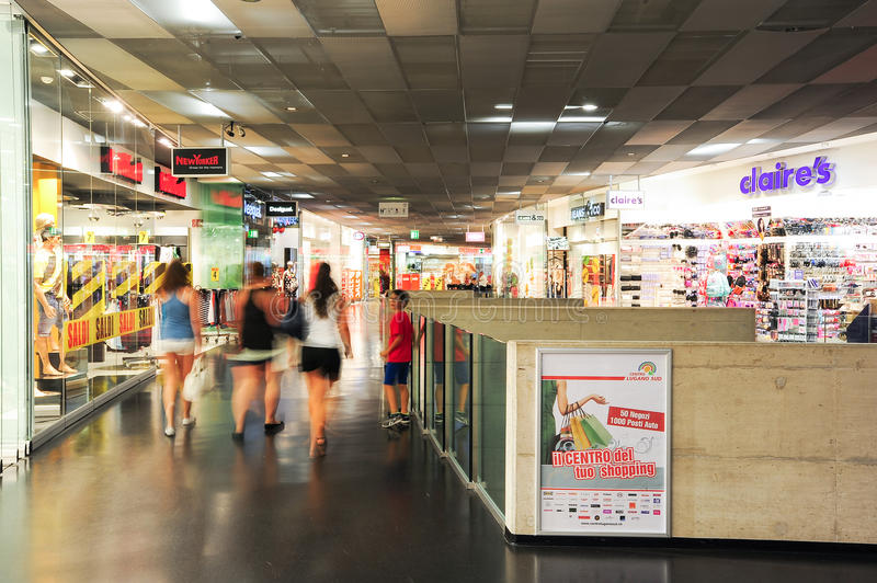 People shopping on walking on the stores of the mall. Lugano, Switzerland - 17 july 2014: people shopping on walking on the stores of the mall at Lugano on stock image