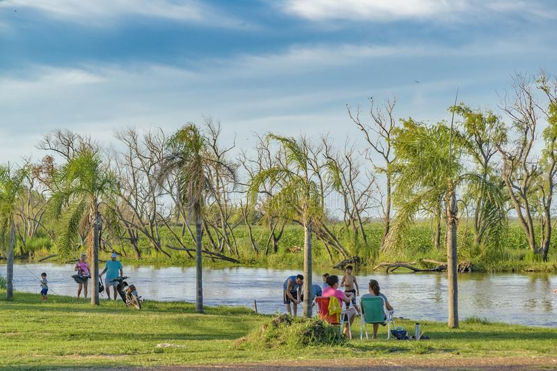 People at Shore of River, San Nicolas, Argentina. SANTA FE, ARGENTINA, JANUARY - 2017 - People enjoying a summer day at shore of parana river in San Nicolas city royalty free stock images