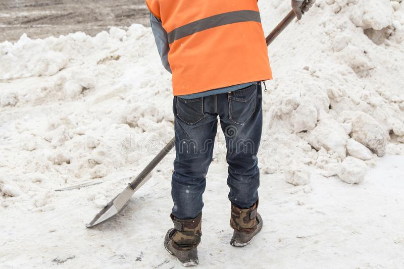 People shoveling snow. Snow clearance after a heavy snowfall stock photos
