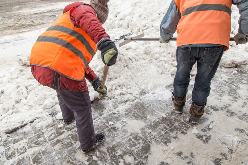 People shoveling snow after a heavy snowfall royalty free stock photos