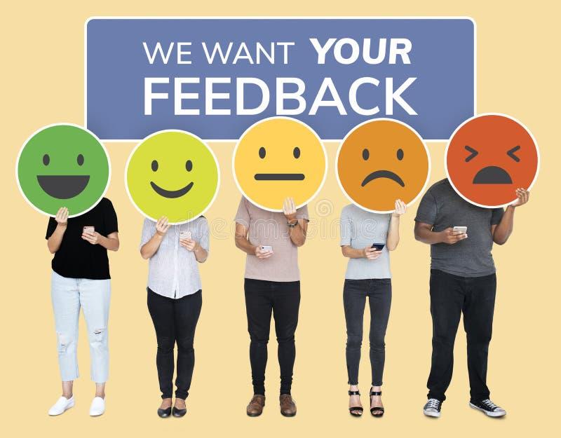 People showing customer feedback evaluation emoticons stock image