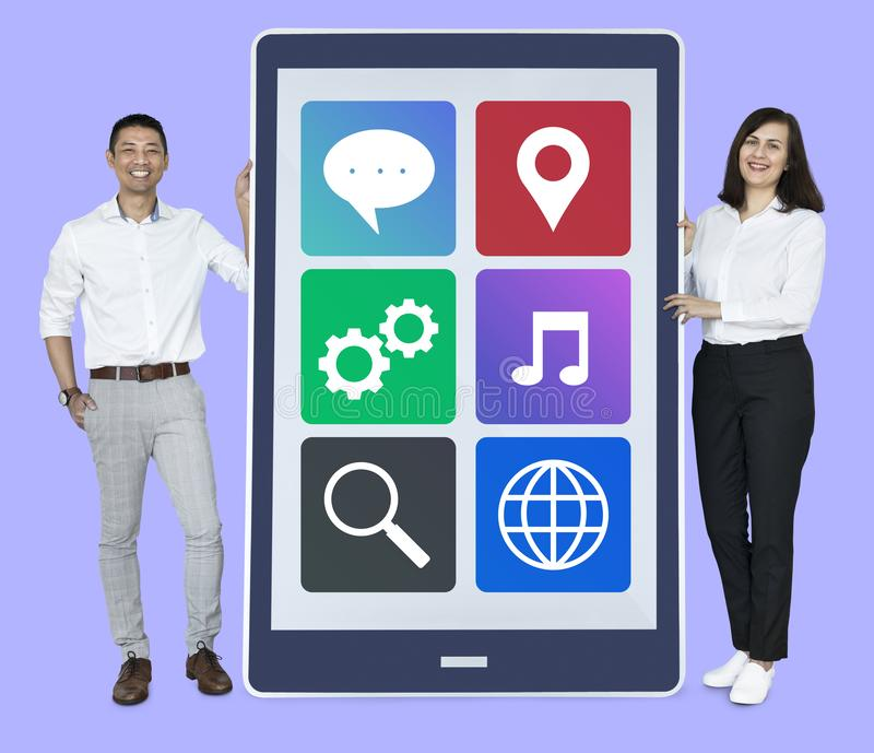 People showing a screen with applications royalty free stock image