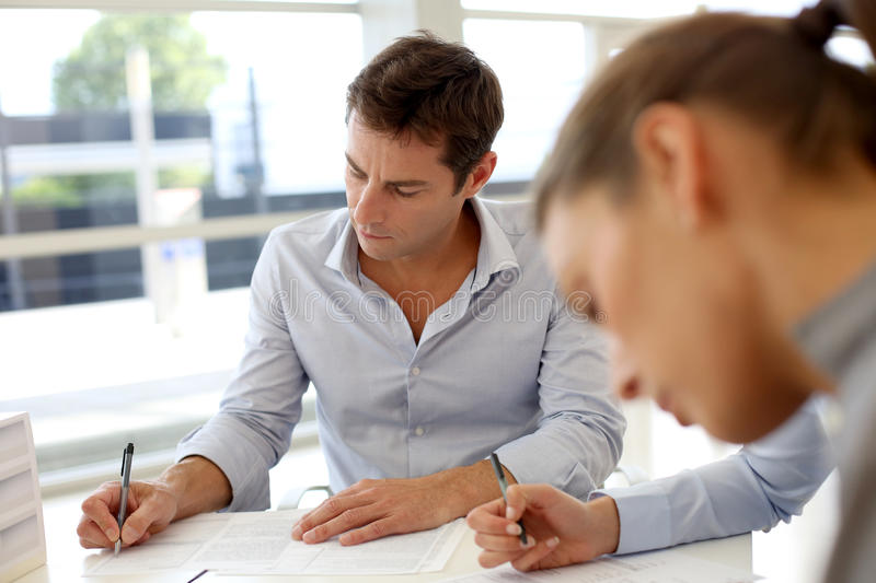 People signing contracts stock photo