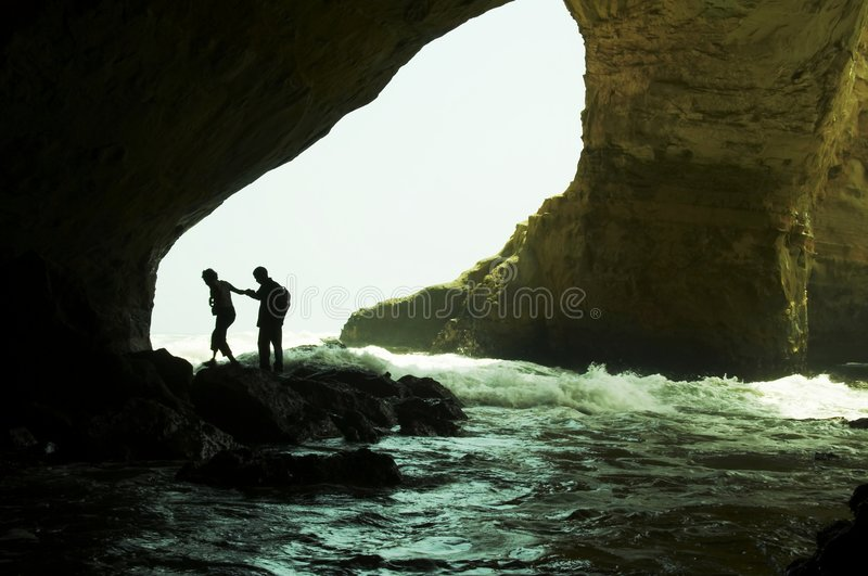 People silhouette in grotto stock photography