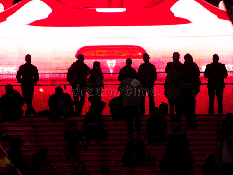 Download People Silhouetted Against Huge Video Screen. Stock Image - Image: 8187059