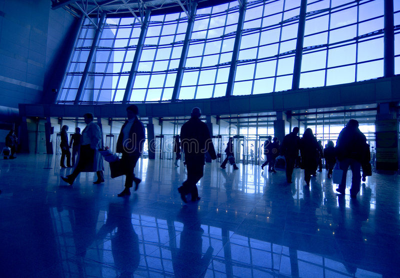 People silhouettes at airport stock photo