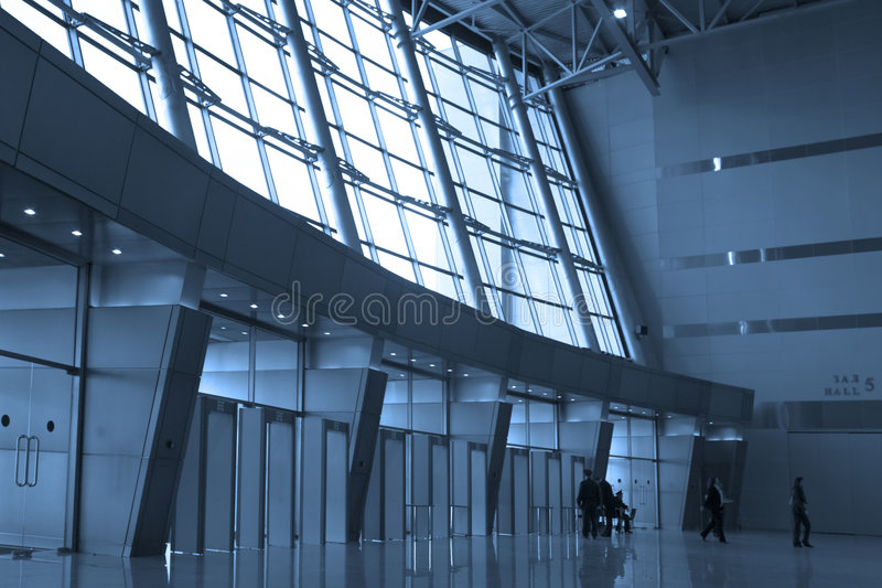 People silhouettes at airport. Building stock image