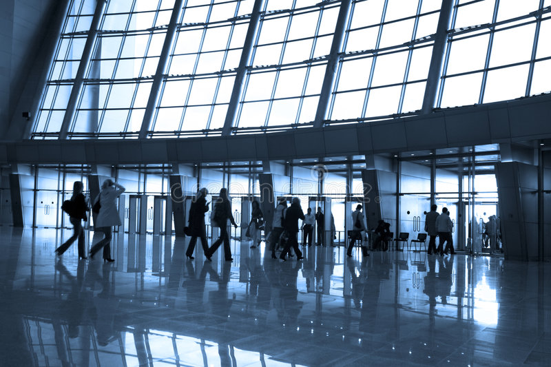 People silhouettes at airport. Building royalty free stock photo