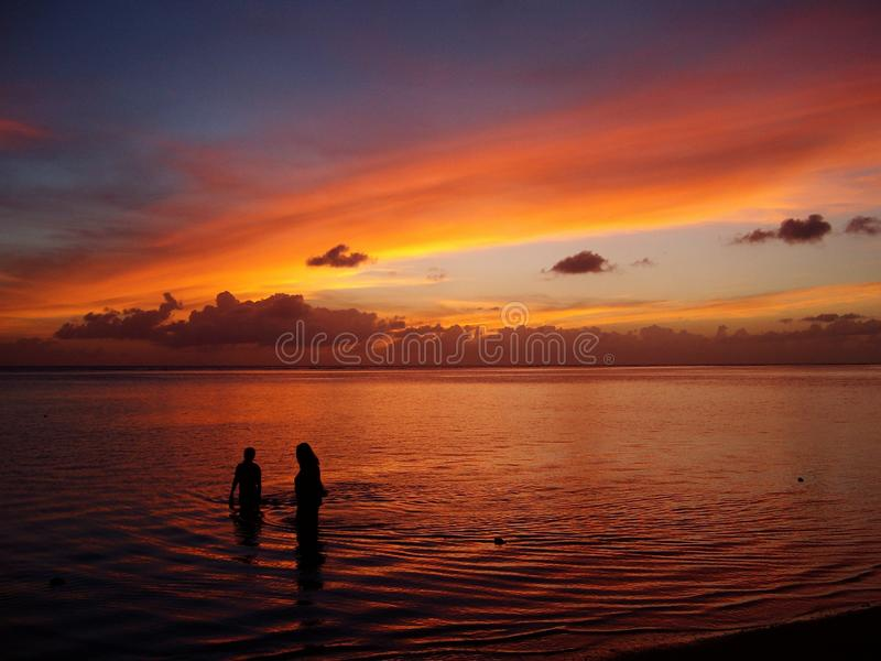 People silhouettes at sunset royalty free stock photography
