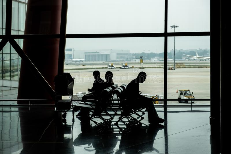 People silhouettes  in Airport terminal. People silhouettes waiting in Airport terminal royalty free stock photo