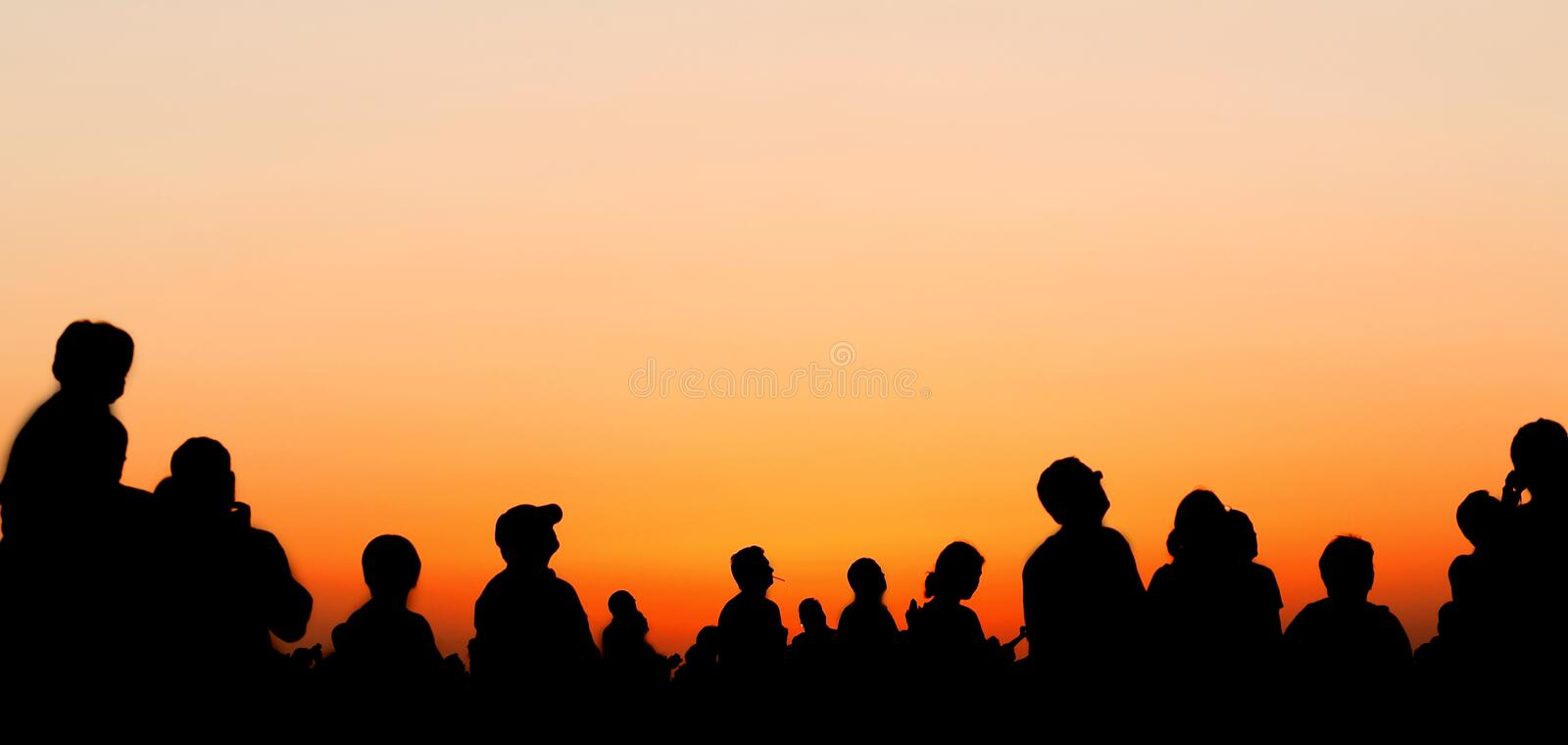 People silhouettes watching sunset sky. During airshow royalty free stock photography