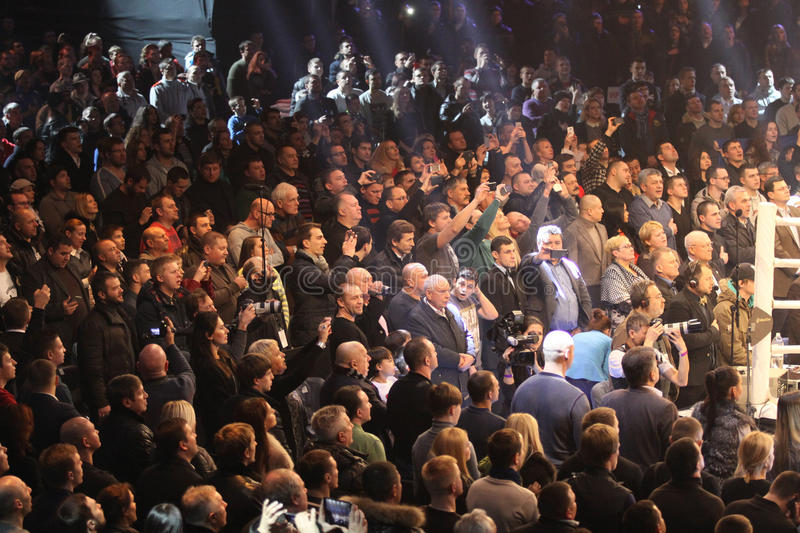 People sing the National Anthem before boxing fight. KYIV, UKRAINE - DECEMBER 13, 2014: People sing the National Anthem of Ukraine before WBO Intercontinental stock photos