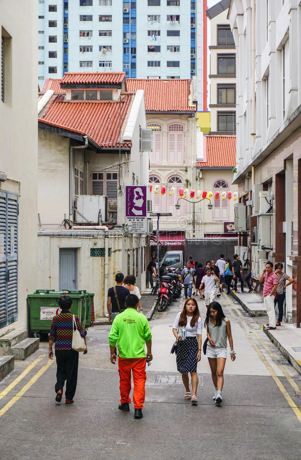 People in Singapore. People walking on street in Chinatown, Singapore. Buddhism is the most widely practised religion in Singapore, with 33% of the resident royalty free stock images