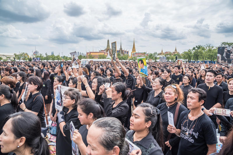 People singing the anthem and hold the portrait of Thai king. Bangkok, Thailand - October 22,2016 : Thai people singing the anthem and hold the portrait of His royalty free stock photos