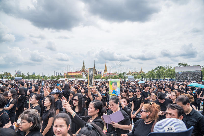 People singing the anthem and hold the portrait of Thai king. Bangkok, Thailand - October 22,2016 : Thai people singing the anthem and hold the portrait of His stock photos