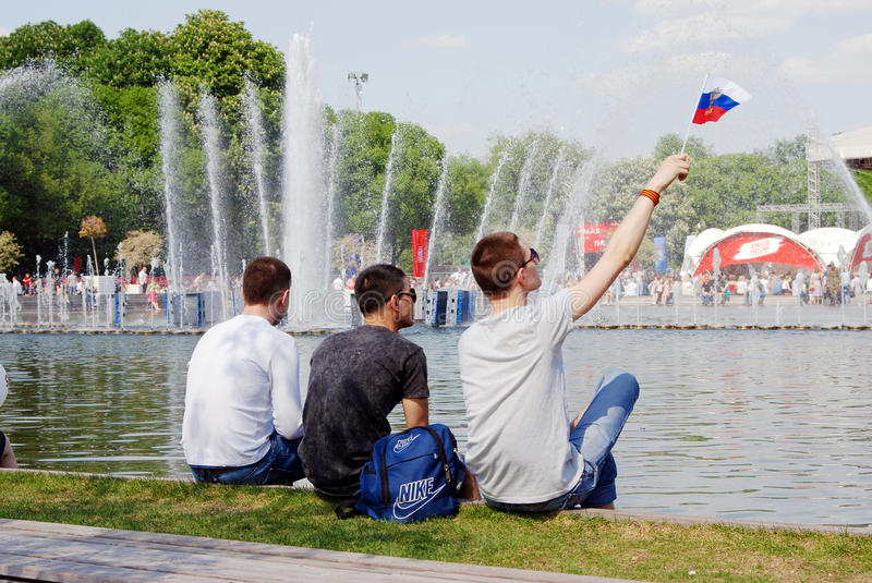 People sit and watch the concert in Gorky park in Moscow stock photos