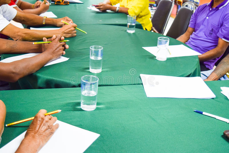 People Sitting Around Table Having Meeting,planing meeting royalty free stock photos