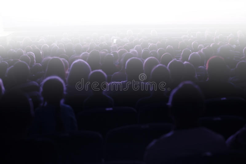 People sitting in an audience royalty free stock image