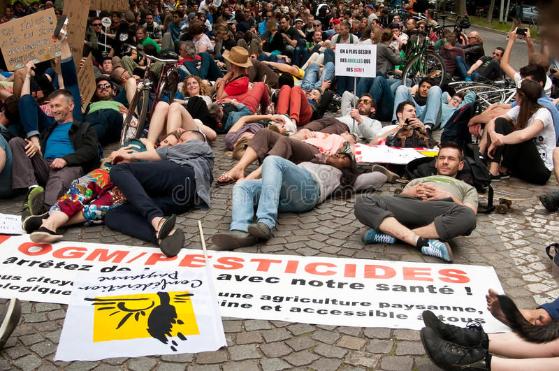 People sitting during the demonstration against Monsanto and the transatlantique treated fo stock photo