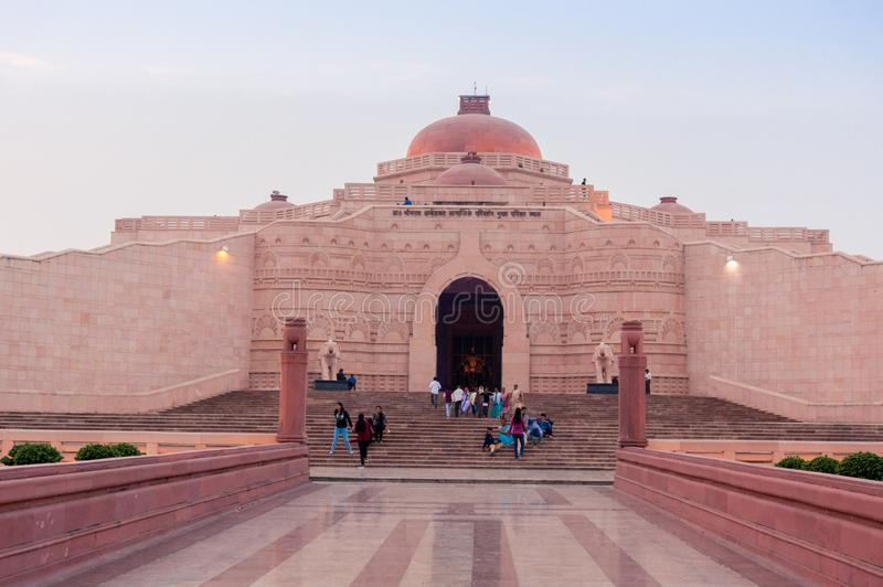 People sitting at the entrance of the Stupa at Ambedkar Park royalty free stock images