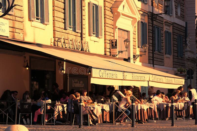 People Sitting Outside Caffetteria during Daytime stock photography