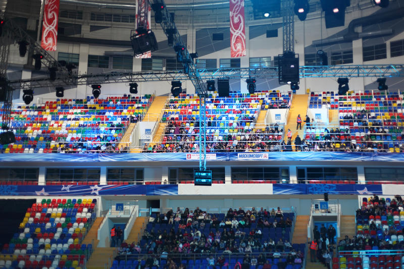 People sitting in Palace of Sports Megasport stock photos