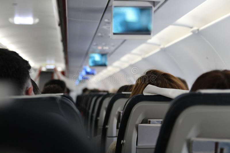 People are sitting on the plane royalty free stock photo