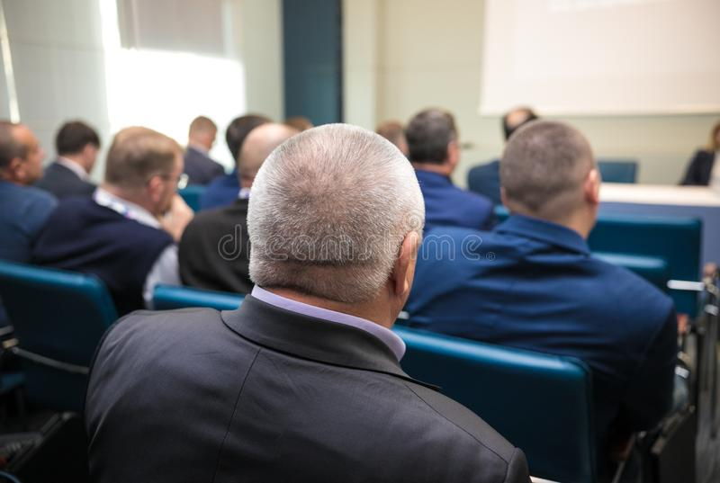 People sitting rear at the business conference stock photo