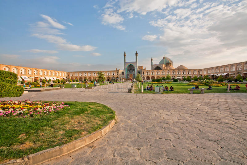 People sitting and relaxing on the green grass of famouse Imam Square stock photography