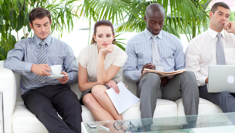People sitting on a sofa waiting for an interview stock photography