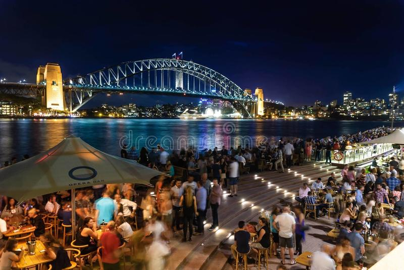 People Sitting and Standing Near Bridge during Nighttime royalty free stock image
