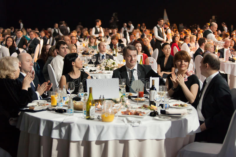 People sitting at the tables during Ceremony of rewarding stock images