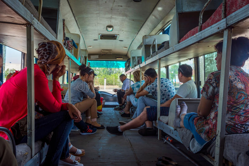 People sitting and waiting on the old bus stock image