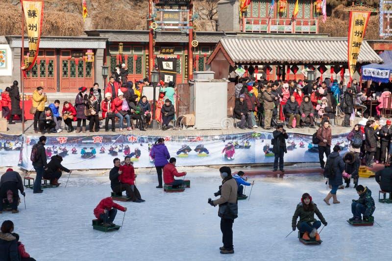 People skating on frozen lake stock photo