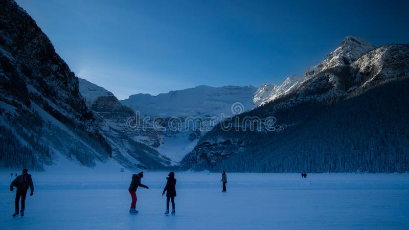 People skating on the frozen lake louise. royalty free stock photography