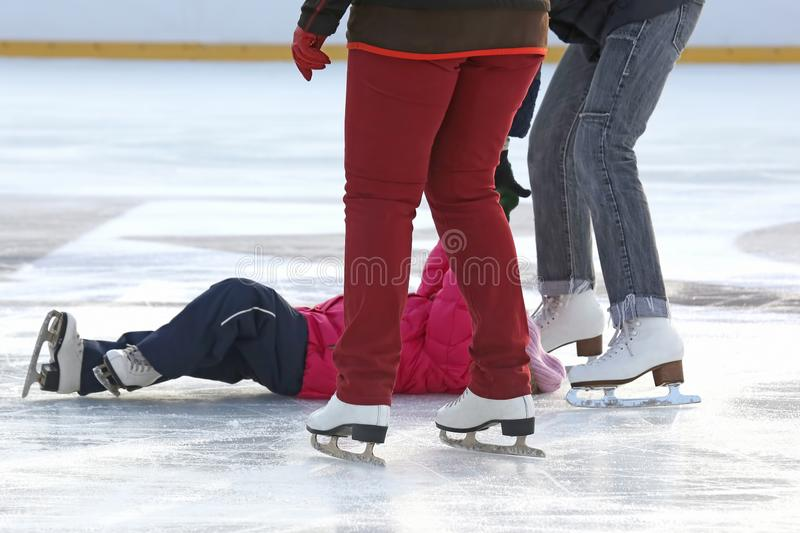 People skating on the ice rink. The people skating on the ice rink royalty free stock images