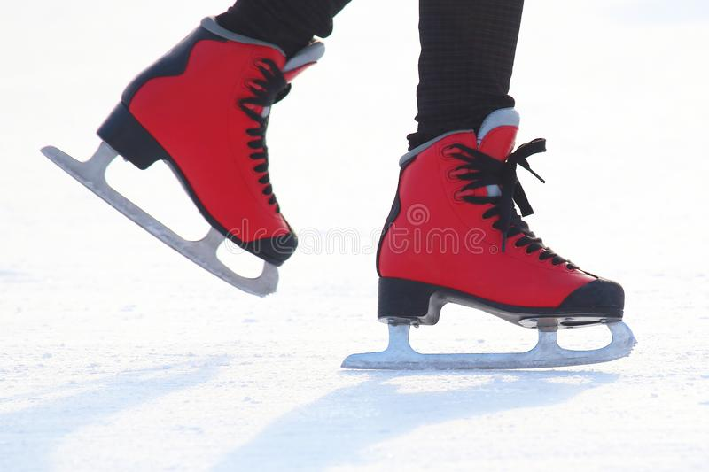 People skating on the ice rink. The people skating on the ice rink royalty free stock photography